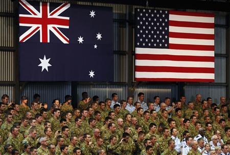 Troops watch U.S. President Barack Obama talk to U.S. Marines and Australian troops at the RAAF Base in Darwin, November 17, 2011.  REUTERS/Larry Downing