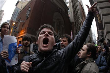 Occupy Wall street demonstrators protest on the streets of lower Manhattan near the New York Stock Exchange during what organizers called a ''day of action'' in New York, November 17, 2011.  REUTERS/Mike Segar