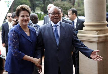 Brazilian President Dilma Rousseff (L) is welcomed by South African President Jacob Zuma before the start of the fifth India-Brazil-South Africa summit (IBSA) in Pretoria, October 18 2011. REUTERS/Siphiwe Sibeko