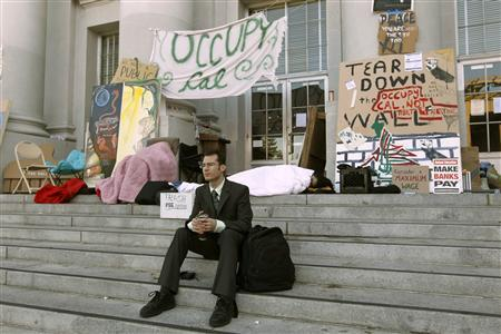 Student Michal Young sits on the steps of Sproul Hall at the University of California Berkeley in Berkeley, California November 16, 2011, following a general strike the previous day. REUTERS/Robert Galbraith