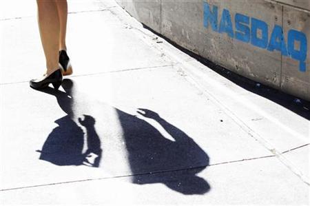 A pedestrian walks past the NASDAQ building in New York City, April 30, 2010. REUTERS/Lucas Jackson