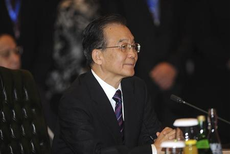 Chinese Premier Wen Jiabao attends the ASEAN-China Commemorative Summit on the sidelines of the ASEAN and Related Summits in Nusa Dua on the Indonesian island of Bali November 18, 2011.  REUTERS/Sonny Tumbelaka/Pool