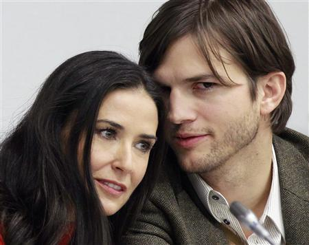Demi Moore and Ashton Kutcher at a news conference at the United Nations Headquarters in New York, November 4, 2010. REUTERS/Brendan McDermid
