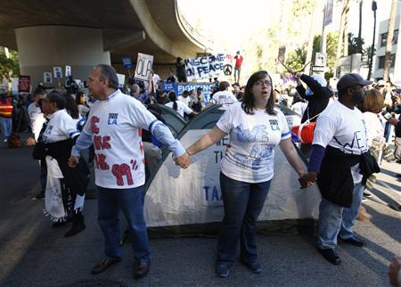 Protesters, organized by Good Jobs LA and Occupy Los Angeles, demonstrate in the downtown financial district of Los Angeles, California November 17, 2011.  REUTERS/David McNew