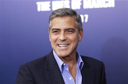 Director and cast member George Clooney smiles as he arrives for the premiere of his film ''The Ides of March'' in New York October 5, 2011. REUTERS/Lucas Jackson