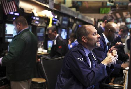 Traders work on the floor of the New York Stock Exchange November 18, 2011. REUTERS/Shannon Stapleton