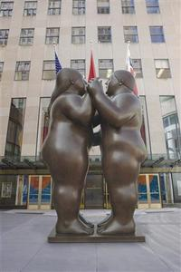 An undated handout photo shows Fernando Botero's 2007 bronze sculpture ''Dancers'', released to Reuters on November 16, 2011. The sculpture, weighing 3,500 pounds and standing at 10 feet 5 inches tall, sold for $1.76 million at Christie's Latin American sale on Tuesday evening. The sale set a record high price for a Botero sculpture at auction. REUTERS/Christie's/Handout