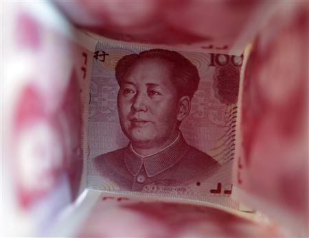 A 100 yuan note is surrounded by other 100 yuan notes in Beijing, in this file picture illustration taken March 22, 2011.  REUTERS/Jason Lee/FIles