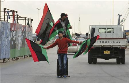 Libyans celebrate after news of Saif al-Islam Gaddafi's arrest, near the courthouse in Benghazi November 19, 2011. REUTERS/Esam Al-Fetori