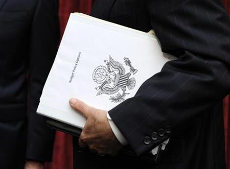 Congressional Super Committee member Sen. Jon Kyl (R-AZ) carries a binder titled Budget Policy Options as he departs the inaugural meeting, as the members search for at least $1.2 trillion in new deficit reductions, in Washington, DC, September 8, 2011.         REUTERS/Mike Theiler