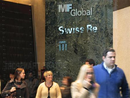People walk through the office complex where MF Global Holdings Ltd have an office on 52nd Street in midtown Manhattan New York, October 31, 2011.  REUTERS/Brendan McDermid