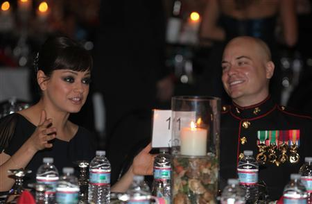 Sergeant Scott Moore and his guest, actress Mila Kunis, attend the 236th Marine Corps birthday ball for 3rd Battalion, 2nd Marine Regiment, 2nd Marine Division in Greenville, North Carolina November 18, 2011. Picture taken November 18, 2011. REUTERS/Cpl. Johnny Merkley/U.S. Marine Corps/Handout