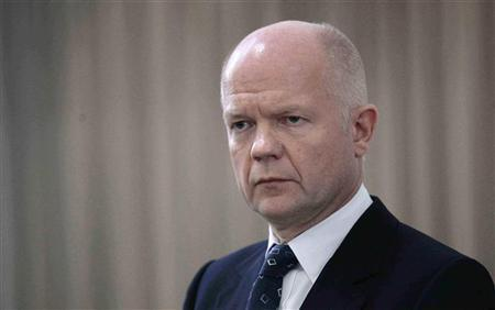 Foreign Secretary William Hague addresses the media during a news conference in Algiers in this October 19, 2011 file photo. REUTERS/Ramzi Boudina
