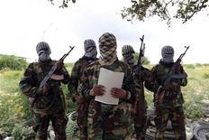Al Shabaab's military spokesman Sheik Abdul Asis Abu Muscab issues a statement south of capital Mogadishu October 19, 2011.  REUTERS/Feisal Omar