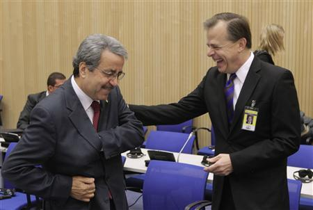 U.S. ambassador to the International Atomic Energy Agency (IAEA) Glyn Davies (R) shares a joke with the Palestinian ambassador to the IAEA Zuheir Elwazer as they attend an IAEA forum at the United Nations headquarters in Vienna November 21, 2011. The forum will focus on how the experiences of regions which have set up Nuclear Weapons-Free Zones (NWFZ), including Africa and Latin America, could be relevant to the Middle East.  REUTERS/Herwig Prammer