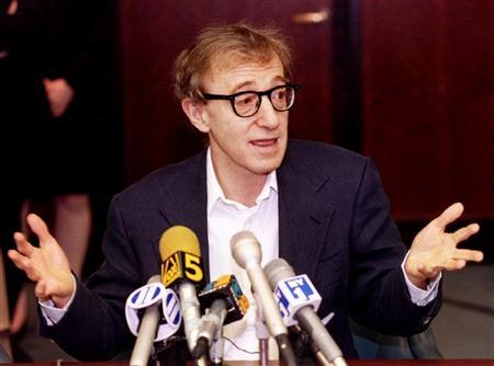 Film director Woody Allen reacts during a press conference in New York June 7, after estranged lover actress Mia Farrow was awarded custody of their three children. REUTERS