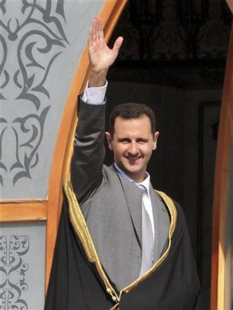 Syria's President Bashar al-Assad greets the crowd during his visit to Raqqa city in Eastern Syria, November 6, 2011, in this handout photograph released by Syria's national news agency SANA. REUTERS/SANA/Handout (SYRIA - Tags: POLITICS TPX IMAGES OF THE DAY) FOR EDITORIAL USE ONLY. NOT FOR SALE FOR MARKETING OR ADVERTISING CAMPAIGNS. THIS IMAGE HAS BEEN SUPPLIED BY A THIRD PARTY. IT IS DISTRIBUTED, EXACTLY AS RECEIVED BY REUTERS, AS A SERVICE TO CLIENTS