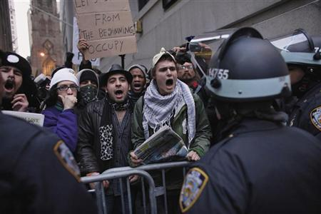 Protesters affiliated with the Occupy Wall Street movement shout slogans to police officers while they march to the New York Stock Exchange November 19, 2011.  REUTERS/Eduardo Munoz