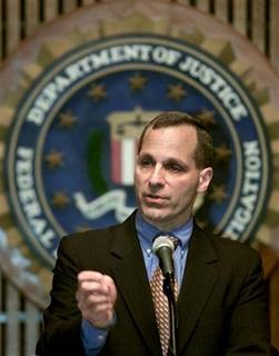 In this file photo, FBI Director Louis Freeh remarks about today's indictment of 13 Saudis and a Lebanese for the 1996 Khobar Towers bombing in Saudi Arabia, during a press conference in Washington, June 21, 2001. REUTERS/Kevin Lamarque