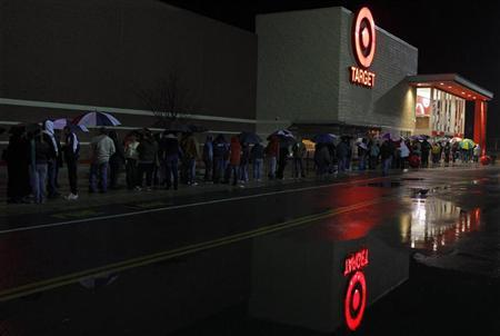 Black Friday shoppers wait for a Target store to open in Lanesborough, Massachusetts November 26, 2010.        REUTERS/Adam Hunger