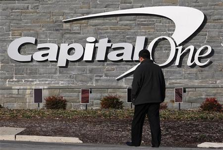A man walks to a Capital One building in McLean, Virginia, January 21, 2010. REUTERS/Jim Young