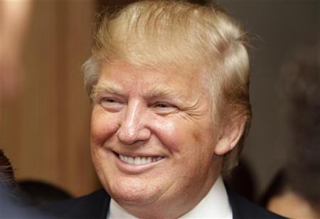 U.S. property magnate Donald Trump smiles during the inauguration of the Trump Ocean Club in Panama City July 6, 2011. REUTERS/Alberto Lowe