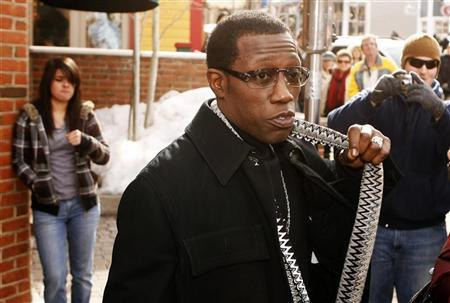 Actor Wesley Snipes gestures on the street during the Sundance Film Festival in Park City, Utah January 17, 2009. REUTERS/Lucas Jackson