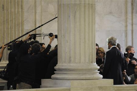 Senator John Kerry (D-MA) (R, back to camera) is surrounded by reporters as he gives an on-camera interview about the ''super committee'' near his office on Capitol Hill in Washington November 21, 2011.     REUTERS/Jonathan Ernst