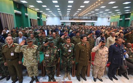 Delegates sing the national anthem during the first General Conference of the National Army in Benghazi November 20, 2011. REUTERS/Esam Al-Fetori