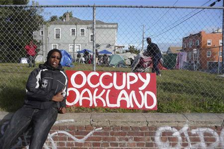 Julion Lewis-Tatman occupies a privately-owned lot in the name of ''Occupy Oakland'' with fellow protesters in Oakland, California November 22, 2011. Driven from three other sites this month, members of ''Occupy Oakland'' set up camp on a vacant lot in West Oakland Monday night, claiming to have permission from the owner, who faces foreclosure.  REUTERS/Laird Harrison