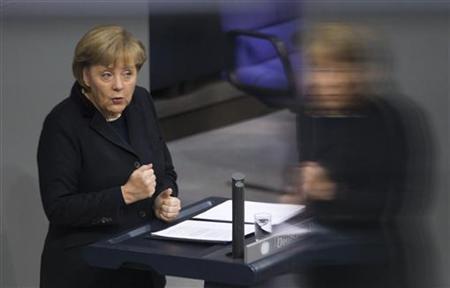 German Chancellor Angela Merkel speaks during a federal budget debate in the Bundestag, the lower house of parliament in Berlin, November 23, 2011.   REUTERS-Thomas Peter