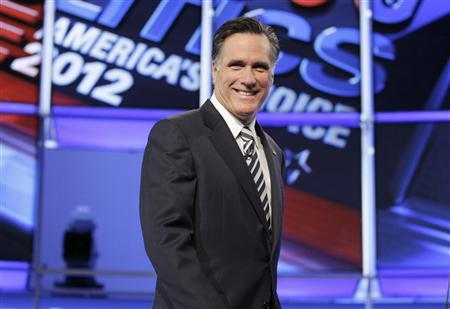 Republican presidential candidate former Massachusetts Governor Mitt Romney takes the stage at the start of the CNN GOP National Security debate in Washington, November 22, 2011. REUTERS/Jim Bourg