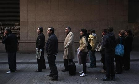 People queue up to buy ''El Gordo'' lottery tickets in downtown Madrid November 16, 2011. REUTERS/Susana Vera