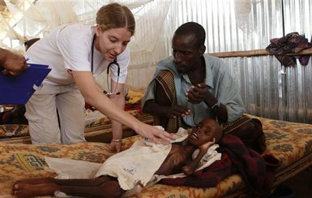 A paramedic from Medecins Sans Frontieres (MSF) attends to Mohamed Hassan, a four-year-old malnourished male refugee from Kansah village in Somalia, at the MSF stabilization centre in Melka Dida, about 75 km (47 miles) from Dolo Ado, near the Ethiopia-Somalia border August 12, 2011. REUTERS/Thomas Mukoya