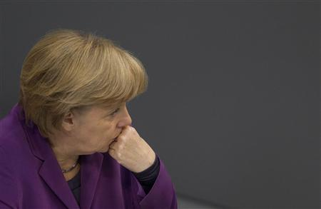 German Chancellor Angela Merkel attends a session of the Bundestag, the lower house of parliament in Berlin, about a neo-Nazi group that had been on a nationwide ten-year killing spree, November 22, 2011.   REUTERS/Thomas Peter