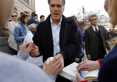 Republican presidential candidate and former Massachusetts Governor Mitt Romney greets supporters at a campaign rally in Nashua, New Hampshire November 20, 2011. REUTERS/Brian Snyder