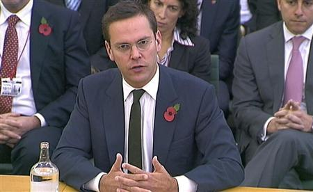 News Corp executive James Murdoch speaks to parliamentarians in London November 10, 2011.   REUTERS/Parbul TV via Reuters TV