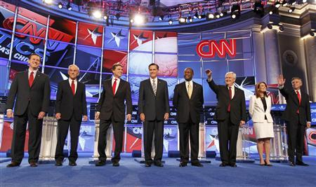 Republican presidential candidates after their introductions during the CNN GOP National Security debate in Washington, November 22, 2011. REUTERS/Jim Bourg