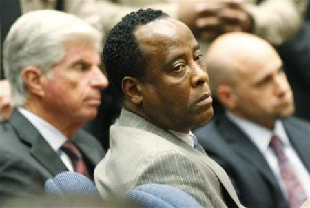 Dr. Conrad Murray remains expressionless next to his attorney J. Michael Flanagan (L) after the jury returned with a guilty verdict in his involuntary manslaughter trial in Los Angeles November 7, 2011. REUTERS/Al Seib/Pool