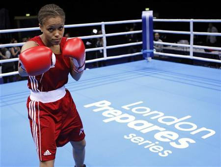 Lightweight British boxer Natasha Jonas, of Liverpool, poses before the Olympic boxing venue test event at the Excel centre in east London November 23, 2011. REUTERS/Andrew Winning