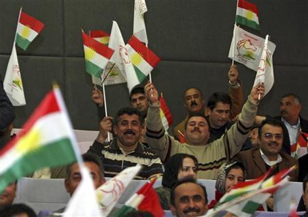 Supporters wave flags of the semi-autonomous region of Kurdistan during a celebration held to present the candidates of Kurdistani Alliance list in Arbil, 310 km (190 miles) north of Baghdad February 12, 2010.  REUTERS/Azad Lashkari