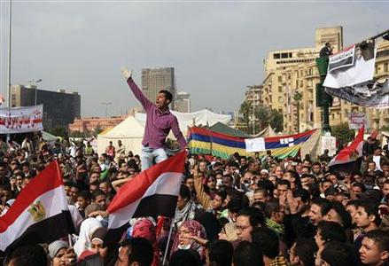 An Egyptian protester chants slogans as protesters gather near concrete barricades around the Interior Ministry, near Cairo's Tahrir Square, November 24, 2011. REUTERS/Esam Al-Fetori