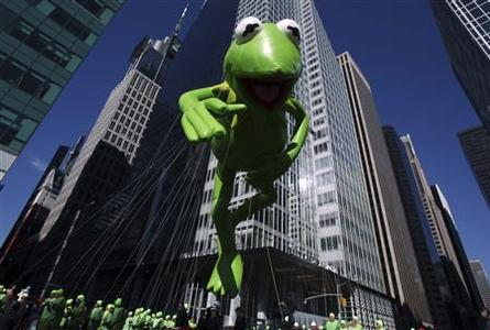 The Kermit the Frog balloon floats down 6th Avenue during the 85th annual Macy's Thanksgiving day parade in New York November 24, 2011. REUTERS-Shannon Stapleton