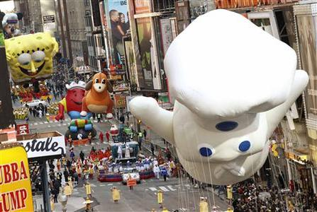 Balloons float down Seventh Avenue through Times Square during the 85th Macy's Thanksgiving day parade in New York November 24, 2011. REUTERS-Brendan McDermid