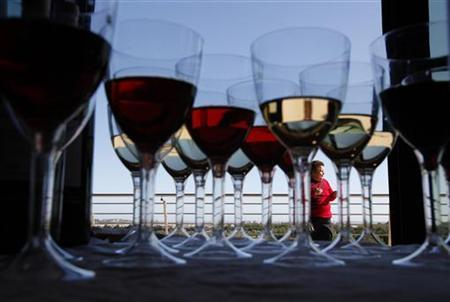 A woman attends the Vivanda Taste the Med food festival as glasses of red and white wine are placed on a display table at Ta' Qali, outside Valletta November 6, 2011.REUTERS/Darrin Zammit Lupi