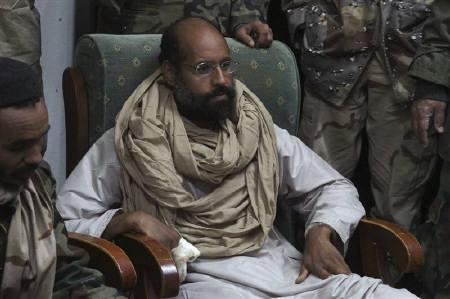 Saif al-Islam is seen after his capture, in the custody of revolutionary fighters in Obari, Libya November 19, 2011. REUTERS/Ammar El-Darwish