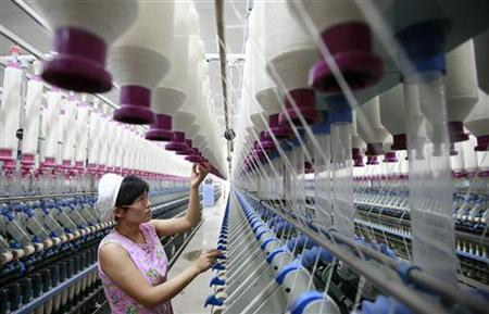 A labourer works at a textile mill in Huaibei, Anhui province September 22, 2011. REUTERS/Stringer