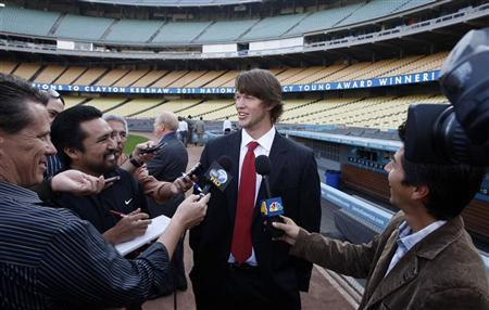 Los Angeles Dodgers' left-handed pitcher Clayton Kershaw, 23, talks to reporters after winning the National League Cy Young Award in Los Angeles, California November 17, 2011.  REUTERS/David McNew