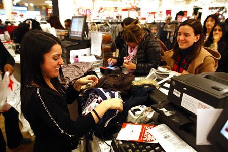 Customers shop at Macy's department store in New York November 25, 2011.  REUTERS/Eric Thayer