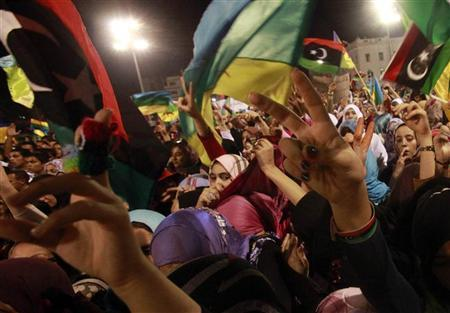 Members of the Libyan Amazigh or Berber ethnic group celebrate at a rally at Martyrs' Square in Tripoli September 27, 2011. REUTERS/Suhaib Salem